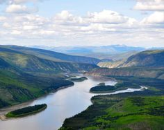 """YK – Yukon River, Yukon, Canada, viewed from the Midnight Dome lookout outside of Dawson. To Build A Fire (1908) by Jack London: """"The Yukon lay a mile wide and hidden under three feet of ice. ...that led south five hundred miles to the Chilcoot Pass, Dyea, and salt water; and that led north seventy miles to Dawson..."""" https://www.google.ca/maps/place/Midnight+Dome+Viewpoint/@64.067921,-139.4669079,12z/data=!4m5!3m4!1s0x5148e3c33e4cc4bb:0xcb1954a811990557!8m2!3d64.0679187!4d-139.3968701"""