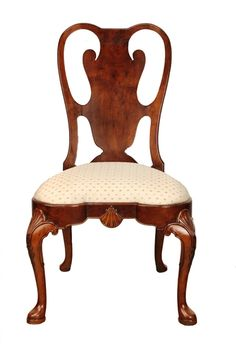Crafted of hand-carved burl elm, this Queen Anne-inspired side chair feels more like a regal throne than simple dining chair.  Its shapely seat mirrors its lyrical back and grand cabriole legs. Custom made by Agostino Antiques. Available in select wood tone finishes and any Benjamin Moore Paint Color finish. Ask a sales associate for details.