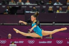 Romania's gymnast Larisa Andreea Iordache, 16, performs on the floor during the artistic gymnastics women's individual all-around final at the London 2012 Olympic Games.  (Miguel Medina / AFP / Getty Images) / SF