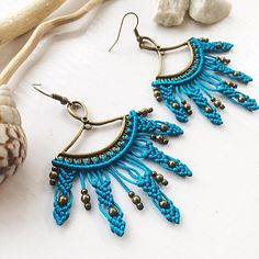 Boho turquoise macrame earrings. The size is 3 inch with earwire. Materials: turquoise nylon macrame cord 0,8mm, bronze beads 2mm and 4mm, bronze connector, nickel free earwire. my own idea of design and work. bright earrings will make your look tribal and attractive good choice