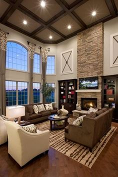 Contemporary Living Room with Box ceiling, Hardwood floors, High ceiling, Arched window, stone fireplace, Built-in bookshelf