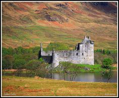 Kilchurn Castle situated at the head of Loch Awe built in about 1450. West Highlands Scotland.... we spent hours here... have to walk a dirt path from a tiny parking lot with no sign but you can see the castle in the distance.  One of our best memories