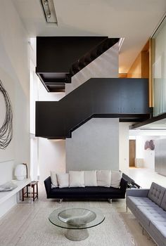 This beautiful line House in London, England is a modern home with lots of character.  The home is full of straight, jagged lines, with small statement pieces distributed throughout the space.