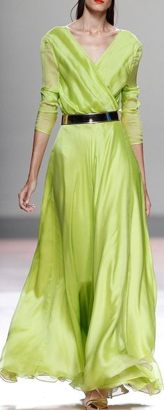 Juan Duyos RTW SS 2014. Bright Spring. In a drape, we can't imagine this colour in clothing. Maybe a reflector stripe on a ski jacket. On a woman of the same colours and lines, you can own the room.