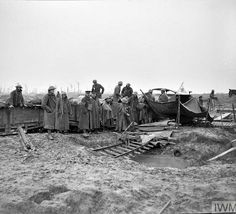 WWI, 10 Oct 1917; Wounded of the 66th Division being moved by light railway, between Langemarck and Pilckem, during the Battle of Poelcappelle. © IWM (Q 6044)