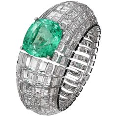 "CARTIER. ""Clarté"" Bracelet - white gold, one 66.09-carat cushion-shaped step-cut emerald from Colombia, rock crystal, onyx, brilliant-cut diamonds"
