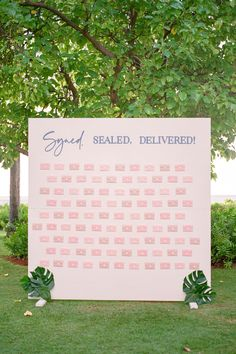 """From the editorial """"Think Tropical Can't Be Timeless? Allow This Hawaiian Wedding Weekend to Prove You Wrong."""" Just wait until you read about the meaning behind their escort card display! Photography: @kerryjeannephoto #escortcarddisplay #weddingseatingchart #weddingideas #tropicalwedding #weddingreception #uniqueweddingideas"""