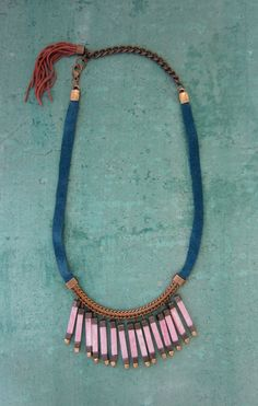 *Peacock blue suede  *Brass chain  *Pyrite  *Ceramic  *African brass  *Silk Tassel  *Adjustable length measures 17-20.5  *Made with love with