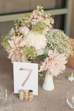 vintage white vase, pastel florals, and cork place card holder <3