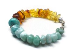 This is a very simple Larimar and Dominican amber bracelet that could be a great gift for Father's day or for a lady. I tried to keep it very simple and unisex