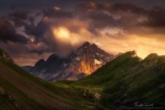 """It's funny walking up the Dolomites and notice how the peaks have so geometric and characteristic shapes without anyone modelling them. I took a """"portrait"""" of the Mount Civetta overlooked by the clouds which are coloured from the early sunset lights. Mount Civetta is a symbol of the Italian Dolomites and there are many climbing trails on it."""