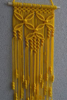 Wall panels handmade macramé technique. Material: 100% polyester. Color: yellow. Strap: natural wood - pine. Dimensions: The length from the wooden plank to the bottom, including the thread - 80cm / 31.5 inches Width - 24cm / 9.5 inches