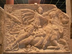 Mithra wearing Phyrgian cup riding on the sacred bull closely fallowed by Sol invictus