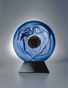 René Lalique's original Le Jour et la Nuit table clock of 1926 depicts…