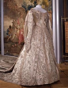 I so wish that there were close-ups on the details of this amazing gown! As lovely as it is, it was torture for the poor young empress. Made of Silver Cloth, she also wore a heavy cloth-of-gold cape, and the state regalia. the end result... The poor dear couldn't stand up on her own after kneeling, and couldn't turn her head at all due to the weight of the jewelry.