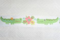 Cute - 22mm wide grosgrain ribbon with crocodiles and flowers.