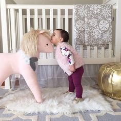 Mrs. Coco Wyse on Instagram: I think it's safe to say Emmy is in love with her new @thelandofnod unicorn and so am I!  She wasted no time giving it a big kiss and I'm sooo happy I got to capture the sweet moment!  Tap pic for more product details or go here:  @liketoknow.it www.liketk.it/20O0Y #liketkit #baby #nursery #love