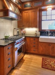Oak kitchen. Love the sink. Maybe replace soffits with little cabinets above and glass doors.