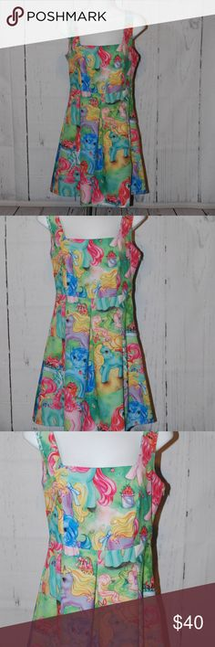 """My Little Pony Tank dress Unique! Rare Medium My Little Pony Tank dress Unique! Rare Medium Adorable Dress Flashback to your childhood with this fantastic piece Smoke free home Measurements laying flat: Please double as needed 17"""" from armpit to armpit 14"""" waist 34"""" from top to bottom hem Dresses Midi"""
