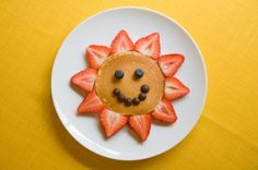 A few creative food ideas for toddlers, including this smiley face pancake.
