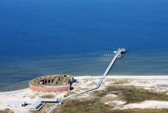 Ship Island (11 miles off the MS coast) - link includes ferry schedule and fares.