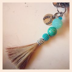 Horse hair keychain, made with beads, and my horse's old halter charm. Created by Shanna Rossi
