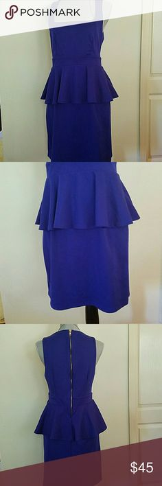 Peplum Dress Cool stretch dress in great cobdition.  Fits amazing. I don't know if it's blue or purple but the color really looks nice.  Gold Zipper detail in back. Soft to the touch..feels like cotton but it's probably Rayon. It has a gentle stretch. Dresses Midi