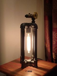 This is a unique, hand crafted, industrial style pipe lamp that will compliment any desk or side table. I personally constructed this lamp of 1/2 raw, black iron pipe and fittings. The faucet-style valve functions as the on/off switch - clockwise to turn on the lamp and clockwise