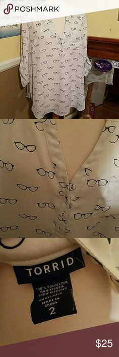 Chic Glasses Torrid Top Perfect condition. Has a cute chest pocket. Sleeves button up. Sheer material. Glasses pattern all over. If you have any questions please feel free to ask! And make offers as I accept almost all! Happy Poshing and Happy Holidays! torrid Tops