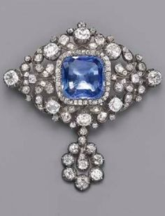 AN ANTIQUE SAPPHIRE AND DIAMOND BROOCH, CIRCA 1870. The central cushion-shaped sapphire within old-cut diamond border to the floral diamond surround and detachable cluster drop, mounted in silver and gold. #antique #brooch
