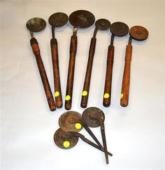 GROUP OF LEATHER BOOKBINDING TOOLS, 19th century, for embossing, most with wooden handles, some marked Hoole Machine Works, Brooklyn, N.Y.; diameter of largest: 5 1/2 inches
