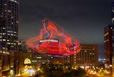 Janet Echelman's Aerial Rope Sculpture Forms A Technicolor Cloud Above Boston