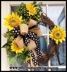 Sunflowers, natural burlap and polka dot ribbon on grapevine, lovely!