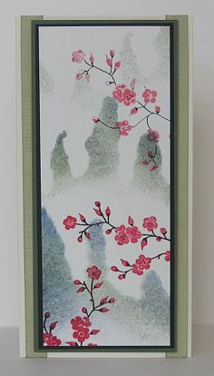 handmade card ... Asian theme ... tall and thin card ... bright stamped cherry blossom branches ... misty looking background with pointy hills ... lovely!!