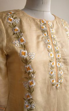 Description: Beautifully done Resham-work around the neck, sides and sleeves Three-quarter sleeves with cuff and Pintucks detail Straight fit