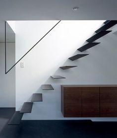 Minimal staircase railing. Ring by Apollo Architects & Associates.