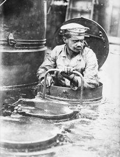 A German sailor emerging topside on a U-boat, August 19, 1915