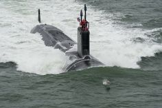 GREAT MILITARY SHOT OF SUBMARINE HEADING OUT TO SEA LED BY A PORPOISE!