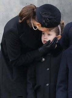 Crown Princess Mary of Denmark comforts her emotional daughter Princess Josephine, seven, as she attends her father-in-law Prince Henrik's funeral in Copenhagen.
