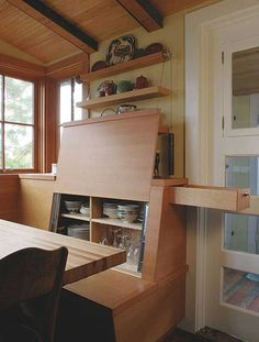 I love this idea of putting storage behind the back of the bench!  Tiny House Movement // Tiny Living // Tiny House on Wheels // Traveling Tiny House // Tiny House Storage // Tiny Home
