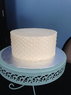 Elegant reproduction of a single tier of the wedding cake for the anniversary.  Topped by fresh flowers at the venue