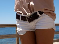 White shorts with thick brown belt