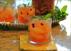 Sweet tea sangria:   1 oz sweet tea vodka ½ oz pomegranate liqueur (e.g. Pama) Splash of orange liqueur (e.g. Patron Citronage) 1 ounce sparkling lime flavored water 1 tablespoon pomegranate arils 1 tablespoon diced pineapple 1 tablespoon mint