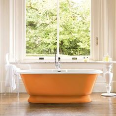 A freestanding bath can often be the main focus of the room so why not draw even more attention to it by painting it a vibrant colour?