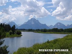 The Grand Teton range reflected in a relatively smooth portion of the Snake River in Grand Teton National Park.