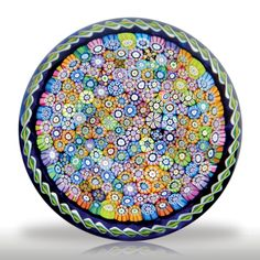 Perthshire Paperweights 1983 close packed millefiori with twist torsade on blue ground paperweight.(333) images