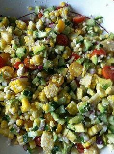 SUMMER SALAD - CORN, AVOCADO, TOMATO, FETA, CUCUMBER & RED ONION WITH A CILANTRO VINAIGRETTE (serves 6-8) - 4 ears corn, cooked - 2 avocados, diced - 2 cups cherry tomatoes, halved (I use orange & red for a little color) - 1/2 an english cucumber, finely diced, skin on - 1/3 C. crumbled feta - 1/2 red onion, finely diced Cilantro Vinaigrette - 1 tbsp. rice wine vinegar - 1 tbsp. white wine vinegar - 1/2 tsp. salt or Herbamare - 1 tsp. garlic powder - 1/2 freshly ground black pepper - 2 tbsp…