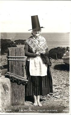 Traditional Welsh dress was worn by women in rural areas of Wales.The distinctive dress was based on a form of bedgown made from wool, of a style dating from the 18th century, worn over a corset. This was teamed with a printed neckerchief, a petticoat, apron and knitted stockings. The dress was completed by a high crowned hat reminiscent of 17th century fashions and a red, caped cloak. Prior to the late 18th / early 19th century there was no such thing as a Welsh national costume.