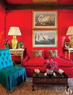 THOMAS BRITT CRAFTS A VIBRANT PIED-À-TERRE IN SAN FRANCISCO LIVING ROOM John James Audubon swan prints are displayed above a living room sofa.