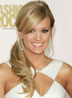 carrie underwood has the best hair and the best bangs.
